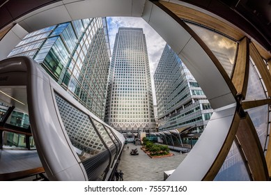 Canary Wharf, London, England - July 2017. A fisheye shot of One Canada Square standing tall among other buildings. View from Crossrail Place, home of the future Elizabeth line station.