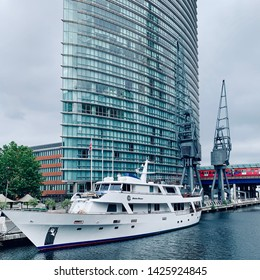 Canary Wharf, London, UK - 15th June 2019: Marriott hotel and the Absolute Pleasure yacht hotel at West India Quay.