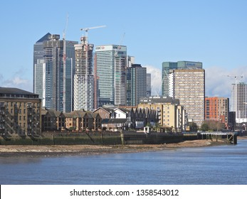Canary Wharf, London / United Kingdom - March 20 2019: Extreme zoom photo of iconic Skyline in Canary Wharf business area