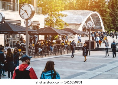 Canary Wharf, London United Kingdom - MAY 28, 2019:  Life style business man, worker and people enjoying outdoor mingle drink, cafe and Restaurants in the business park  square in Canary Wharf