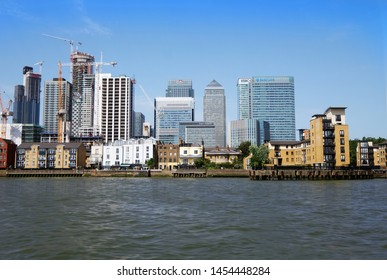 Canary Wharf, London, United Kingdom 7th July 2019: UK financial district Canary Wharf seen from River Thames near North Greenwich, showing skyline and major construction projects