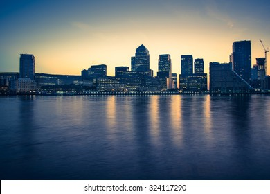 Canary Wharf modern buildings in London on river Thames, filtered image