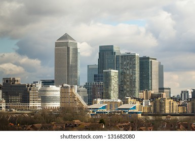 Canary Wharf and surrounding skyscrapers taken from a roof in South East London