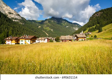 CANAZEI, ITALY - AUGUST 1, 2014: Small village Penia near Canazei and under Marmolada glacier, Val di Fassa, Dolomites, Italy. Penia has cable car connection to Ciampac and Belvedere ski arenas.