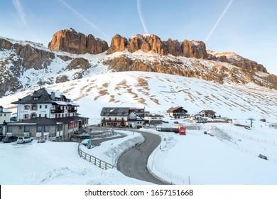CANAZEI, ITALY - FEBRUARY 24, 2016: Twilight in Passo Pordoi near Canazei, Dolomites, Italy