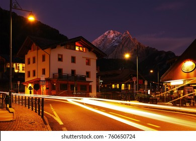 CANAZEI, ITALY - OCTOBER 27 - 2016 - Nightscape in Canazei Resort with Peak Vernel, the base station for many excursions and rock climbs to the Sella Marmolada and Sassolungo Group, Dolomites, Italy