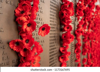 Canberra, ACT, Australia - Sept 1 2018: poppy decoration next to the wall of fallen soldiers at the Australian War Memorial - Lest we forget, Remembrance of war losses.