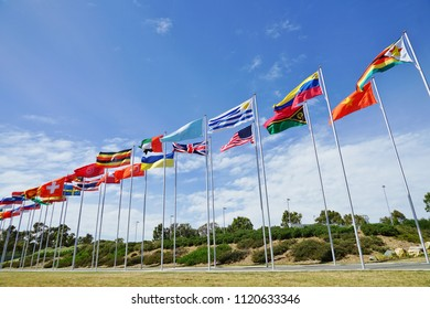 CANBERRA, AUSTRALIA -12 DEC 2016-View of international flags from many countries flying by the Parliament of the Commonwealth of Australia (Australian Parliament) in the Australian Capital Territory.