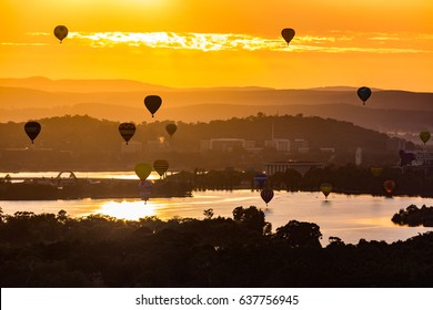 Canberra, Australia, 12 March 2017. Hot air balloons are floating over the lake burley griffin in Canberra during sunrise.