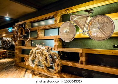 Canberra, Australia - Apr 22, 2018: Bicycles hanging on the wall adjacent to the lobby of the Ovolo Nishi Hotel. The bikes are decorated with stylish contemporary design elements.