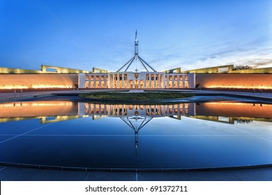 Canberra, Australia- April 14, 2016: Dramatic evening sky over Parliament House, illuminated at twilight. Which was the world's most expensive building when it was completed in 1988.