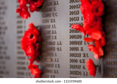 CANBERRA, AUSTRALIA - JULY 20, 2010: Poppies with the name of soldiers and the statue at the Australian War Memorial