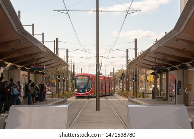 Canberra, Australia - July 3rd 2019: A Canberra Metro Light Rail Vehicle Arriving at a Platform, Alinga Street Stop, in the middle of Canberra Civic's Northbourne Avenue.