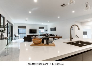 CANBERRA, AUSTRALIA – JUNE 2, 2018: View of the spacious combined dining and lounge room from the kitchen island in a modern home
