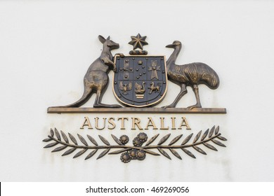 Canberra, Australia - June 28, 2016: View of The Commonwealth Coat of Arms, the formal symbol of the Commonwealth of Australia, in bronze outside the old Parliament House.