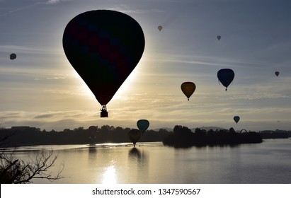 Canberra, Australia - March 10, 2019. Hot air balloons flying in the air above Lake Burley Griffin, as part of the Balloon Spectacular Festival in Canberra.