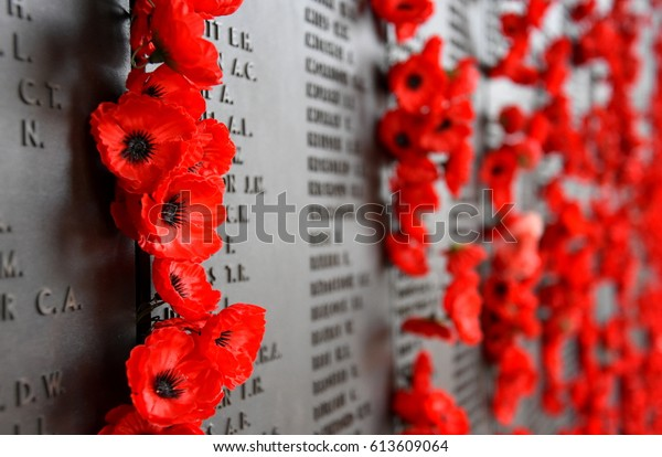 Canberra, Australia - March 18, 2017. Poppy wall lists the names of all the Australians who died in service of armies. The red poppy has become a symbol of war remembrance (ANZAC Day) the world over.