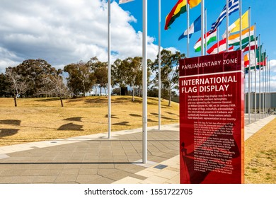 """Canberra, Australia - Sep 3, 2018: Information sign to the """"Avenue of Flags"""" at the Parliamentary Zone along Queen Elizabeth Terrace."""