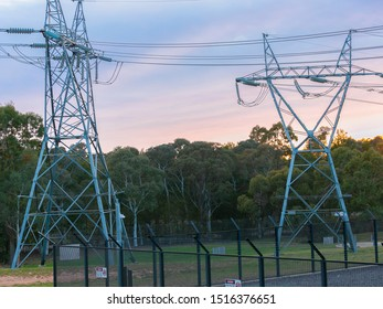 CANBERRA, AUSTRALIA – September 28, 2019: Transmission tower and overhead powerlines alongside a power station for the supply of energy to households in Canberra, the Australian Capital Territory