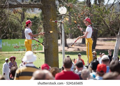 Canberra, Australia-September 28, 2008. Two buskers perform their acrobatic and fire juggling routine in an outdoor park in Canberra, Australian Capital Territory