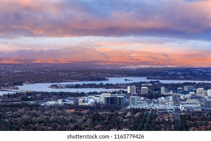 Canberra city under snow capped mountains