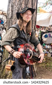Canby, Oregon - June 9, 2019: Musician playing electric mandolin dressed in renaissance period costume at a Renaissance Fair.
