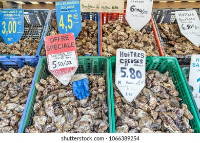 CANCALE, FRANCE - AUGUST 1, 2014: Crates with fresh oysters for sale at the french coast of Brittany (Bretagne) in Cancale, France, on August 1, 2014