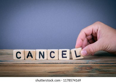 cancel, wooden letters on the office desk, informative and communication background