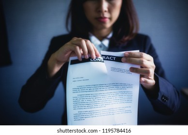 Canceled contract. business woman tearing up a document, contract or agreement in office. Legal law and justice concept.