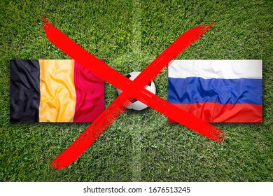 Canceled soccer game, Belgium vs. Russia flags on a green soccer field