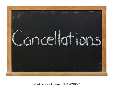 Cancellations written in white chalk on a black chalkboard isolated on white