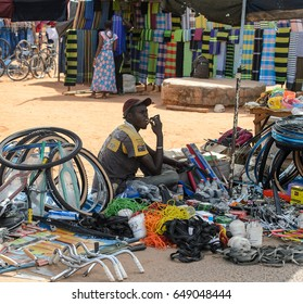 CANCHUNGO, GUINEA BISSAU - MAY 3, 2017: Unidentified local man sells goods in the centre of Canchungo, one of the major cities of the country