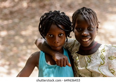 CANCHUNGO, GUINEA BISSAU - MAY 3, 2017: Unidentified local children with braids smile. Bissau-Guinean people suffer of poverty due to the bad economy
