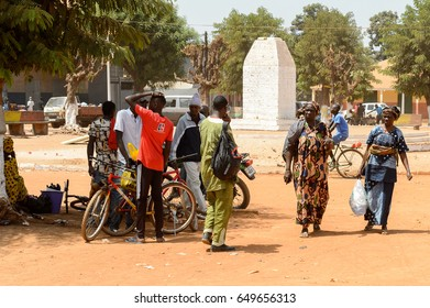 CANCHUNGO, GUINEA BISSAU - MAY 3, 2017: Unidentified local people talk about something in the centre of Canchungo, one of the major cities of the country
