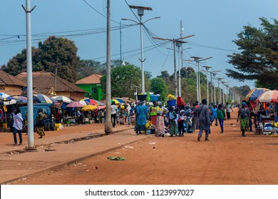 Canchungo, Republic of Guinea-Bissau - February 1, 2018: People in a street market in the town of Canchungo in Guinea Bissau, West Africa.
