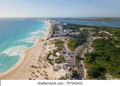Cancun beach panorama aerial view. Aerial view of Caribbean Sea beach.  Zona hotelera top view.  Beauty nature landscape with tropical beach. Caribbean seaside beach with turquoise water and big wave