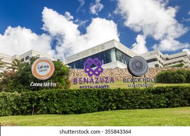 Cancun, Mexico - 12 December 2015: Restaurant Sakura Sunset, Benazuza and Black Hole signs at Grand Oasis Sens