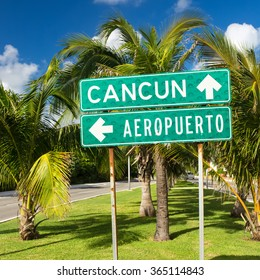 Cancun, Mexico - 12 December 2015: Traffic Sign Airport or Cancun with arrows on the street at Hotel Zone