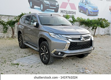 Cancun, Mexico - December, 29, 2017:  Mitsubishi Pajero on the exhibition point, next to Mitsubishi banner.