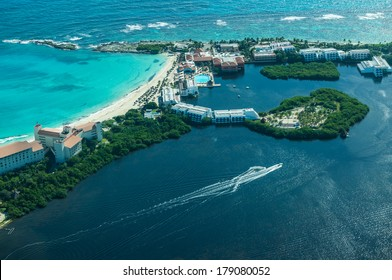 Cancun (Mexico) from bird�s eye view (Cancun's beaches with luxury hotels and  turquoise Caribbean sea and dark lagoon with stunning isles and yachts)
