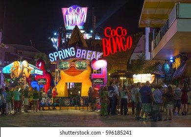 CANCUN, MEXICO - FEBRUARY 28, 2017: Tourists stand in long lines to enter the popular Conco Bongo nightclub in Cancun at the start of Spring Break