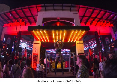 CANCUN, MEXICO - FEBRUARY 28, 2017: Go-go dancers perform at the entrance to Mandala nightclub in Cancun during the Spring break season