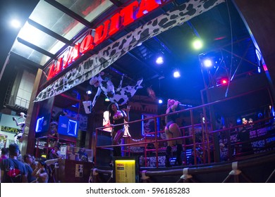 CANCUN, MEXICO - FEBRUARY 28, 2017: Go-go dancers perform nightly at the front of La Vaquita nightclub in Cancun to attract customers