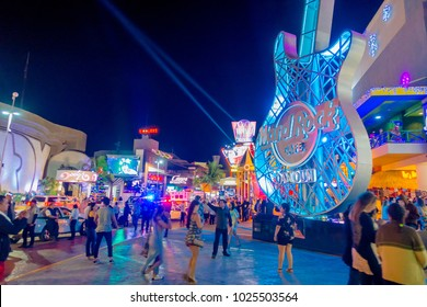 CANCUN, MEXICO - JANUARY 10, 2018: Crowd of people enjoying the night life at outdoors of Hard Rock Cafe in Cancun at the Forum center in Cancun's hotel zone