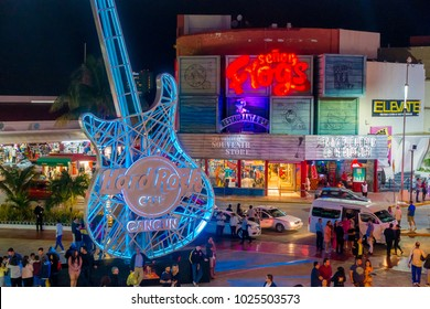 CANCUN, MEXICO - JANUARY 10, 2018: Unidentified people at outdoors of Hard Rock Cafe in Cancun at the Forum center in Cancun's hotel zone enjoying the night life