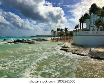 Cancun, Mexico - January 27, 2018: On a windy beach in Cancun.Cancun, a Mexican city on the Yucatan Peninsula bordering the Caribbean Sea, is known for its beaches, numerous resorts and nightlife.