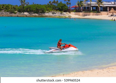CANCUN, MEXICO - JUL 10, 2016: Young Man on Jet Ski, Tropical Ocean, Vacation Concept in  the Caribbean ocean