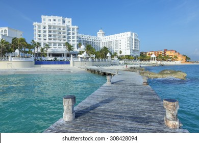 CANCUN, MEXICO - JULY 30, 2015:  Seaside resorts such as Hotel Riu Palace continue to offer quality five-star accommodations along the beautiful Caribbean coastline of Cancun's hotel zone