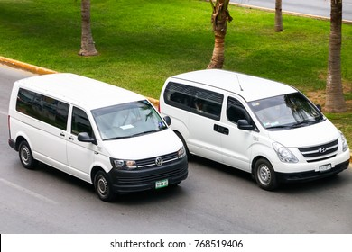 Cancun, Mexico - June 3, 2017: Passenger vans Volkswagen Transporter and Hyundai H-1 in the city street.