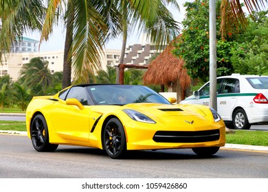 Cancun, Mexico - June 4, 2017: Yellow supercar Chevrolet Corvette in the city street.